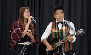 Ngai Di and Simon Di, refugees from Myanmar, sing during Catholic Charities, Diocese of Camden's fifth annual World Refugee Day, hosted by Somerdale Park School. Photo by Mike Walsh