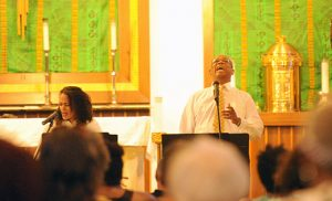 """Ivan Woods sings """"Ain'-a That Good News"""" during a Juneteenth Celebration June 12 at Saint Josephine Bakhita Parish, Camden. Woods is part of a musical trio, Follow the Drinking Gourd, that also includes pianist Diane Goldsmith and singer Singer Shannon Hunt Caldwell. The program, entitled """"The Power of African Music to Inspire,"""" was sponsored by the parish and the Office of Black Catholic Ministry Commission. Photo by Alan M. Dumoff"""