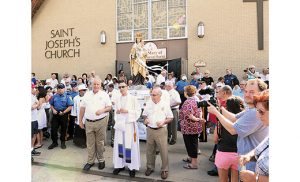 Father Joseph Capella, chaplain of the Our Lady of Mt. Carmel Society, leads the way as the annual procession starts at Saint Joseph Church in Hammonton. From Monday, July 11, until Saturday, July 16, the feast of Our Lady of Mount Carmel, an all-week festival took over downtown Hammonton, bringing thousands together for six days of faith and family.  Photo by Alan M. Dumoff, more photos ccdphotolibrary.smugmug.com