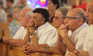 Members of the Our Lady of Mount Carmel Society pray during Mass celebrated by Bishop Dennis Sullivan on July 16 in Saint Joseph Church, Hammonton. Photo by Mike Walsh