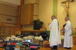 Bringing donated shoes to the altar in Galloway