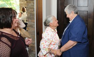 "Sister Grace Marie Scandale, D.M., right, greets Pauline Matise June 25 at the Greenview Inn in Vineland before a dinner in her honor. Sister Grace was recognized for more than 40 years of service to Our Lady of Mercy Academy, first as a teacher and then as principal, a title she held for 36 years. ""As long as Sister Grace Marie has been principal, her door has always been open to the students to stop in to say hello, or if they just needed to talk,"" said Michelle McGrath, OLMA alumnae and former athletic director. ""She always knew the importance of providing opportunities for young women and to develop their individuality, intellect and confidence.""  Photo by Alan M. Dumoff"