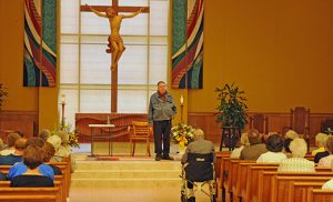 """Jim Nagle of Cleveland, Ohio, performs a one-act, one-person play about the life of Thomas Merton at Christ Our Light Parish, Cherry Hill, on June 25. Merton (1915-68) was a writer and Trappist monk at Our Lady of Gethsemani Abbey in Kentucky. He was the author of more than 70 books that include poetry, personal journals, collections of letters, social criticism, and writings on peace, justice and ecumenism. His autobiography, """"The Seven Storey Mountain,"""" was a bestseller and made him one of the most influential Catholic authors of the 20th century. When Pope Francis spoke to a joint meeting of Congress on Sept. 24, 2015, Thomas Merton was one of the four iconic U.S. citizens he referenced as relevant models of virtue for Americans today, the others being Abraham Lincoln, the Rev. Martin Luther King Jr. and Dorothy Day. Following the play at Christ Our Light, there was a dialogue session with Jonathan Monaldo, a retreat director and editor of """"We Are Already One:Thomas Merton's Message of Hope."""" Photo by Alan M. Dumoff"""
