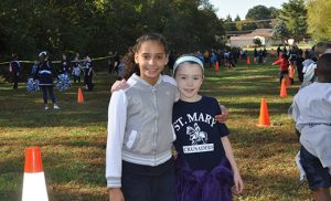 """Advancement directors are actively involved in promoting the Catholic schools' """"Race for Education."""" Pictured in a related event at Saint Mary School in Williamstown are rising fifth graders Milan Quinones, left, and Danielle Russell."""
