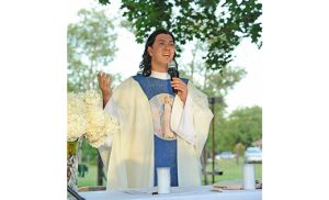 Father Ariel Hernandez, pastor of Our Lady of the Blessed Sacrament, Newfield, celebrates Mass for workers at Cheli Farms, Minotola, on Aug. 11.