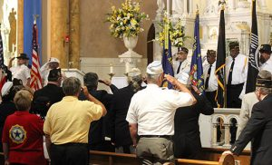 A prayerful salute to military veterans Service members give a final salute before the Retiring the Colors at the end of an interfaith veteran prayer service at Saint Nicholas of Tolentine Church in Atlantic City on Aug. 16. Photos by Mary McCusker