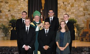 At Blackwood's Our Lady of Hope Parish on Aug.7, Bishop Dennis Sullivan celebrated a Mass and welcoming for new Camden Diocesan seminarians, and one young woman, Lauren Adderly, entering the Society of Our Lady of the Most Holy Trinity religious order. With Bishop after Mass are, back row, Logan Nilsen, George Creel and James Sprenger and, front row, Shawn Tumolo, Cesar Pirateque and Adderly. Sprenger, Creel, Nilsen and Tumolo all will begin formation at Saint Andrew's Hall, Seton Hall University in South Orange, N.J., while Pirateque will study at Seton Hall's Immaculate Conception Seminary. Photo by James A. McBride