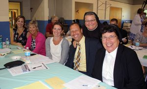 Pictured at an administrators' meeting Aug. 18 in Mays Landing are, from left,  Heather Crisci, principal, Camden Catholic High School, Cherry Hill; Mary Whipkey, president, Camden Catholic; Molly Webb, principal, Resurrection Regional, Cherry Hill; Michael Chambers, president, Paul VI, Haddon Township;  Sister Michele DeGregorio, FMIJ, principal, Saint Margaret Regional, Woodbury Heights; and Sister Marianne McCann, MPF, principal, Paul VI. Photo by Mary Beth Peabody