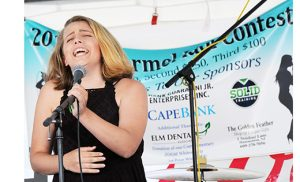 Photo by Alan M. Dumoff, more photos ccdphotolibrary.smugmug.com  Ally Bagliani performs at the fifth annual Idol Contest sponsored by Saint Mary of Mount Carmel Parish, Hammonton, on July 11. The contest was open to area teens ages 14-18.