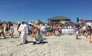 Father Mark Cavagnaro, pastor of Saint Brendan the Navigator Parish, Avalon, leads the procession to the shores of Stone Harbor during the city's Wedding of the Sea celebrations last Sunday evening, the vigil of the feast of the Assumption. Photo by Maria D'Antonio