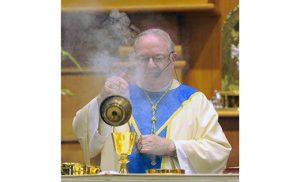 Bishop Dennis Sullivan censes the altar of Saint Ann Church, Notre Dame de la Mer Parish, Wildwood, during Mass for the Vigil of the Assumption, Aug. 14. Photo by Alan M. Dumoff