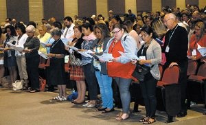 Catechists pray at the Diocesan Religious Education Convocation at Paul VI High School, Haddon Township, on Sept. 17. Photo by James A. McBride
