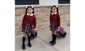 Twins Dianna and Jailyn Perez are enrolled in first grade at Saint John Paul II School in Stratford. Church officials are working to increase Hispanic enrollment in Catholic schools.