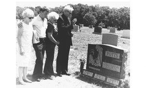 In this 1980 file photo, Bishop Thomas J. Welsh of Arlington, Va., a friend of the Potts family, blesses the headstone. Also present are Eileen's parents, William and Elizabeth Potts of Somerdale, and her grandmother, left, Eleanor Dillon of Glendora. Photo above by James A. McBride