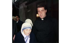 Bishop James F. Checchio, at the time a seminarian for the Diocese of Camden, is pictured with Mother Teresa in Rome.
