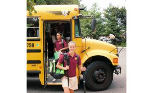 Away with the sandals and sunscreen, in with the school shoes and backpacks. Christ the King Regional School student Mollie Crumpton walks off the bus Sept. 6 for the first day of the new year at the Haddonfield school. Behind her is Nick Sulpizio. All over South Jersey this week, students, staff and teachers in South Jersey's 28 Catholic elementary schools and nine Catholic secondary schools returned to classrooms. On Sept. 7, Bishop Dennis Sullivan kicked off these upcoming months of learning with a Mass for the Saint Mary School community in Vineland. Photo by James A. McBride