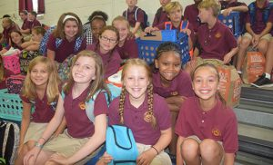 Members of the fifth grade class at Christ the King Regional School in Haddonfield, smile for the camera on the first day back to school, Tuesday, Sept. 6. Photo by Cynthia Soper