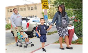 Walking to Saint Vincent DePaul School, Mays Landing, on opening day is the Longo family, above. Father Chris pushes Gino as Kristina holds hands with her son Salvatore. Below, Michelle Phy with her fifth-grade daughter Charley. Photos by Alan M. Dumoff, more photos ccdphotolibrary.smugmug.com
