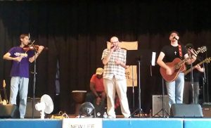 "The musical group Paging Samuel entertains the audience at Praise Fest, held Sept.18 in the school gym at Saint Rose of Lima, Haddon Heights.  The afternoon performance saw the five-piece band play original material, and such standards as ""How Great Thou Art"" and ""Amazing Grace."""