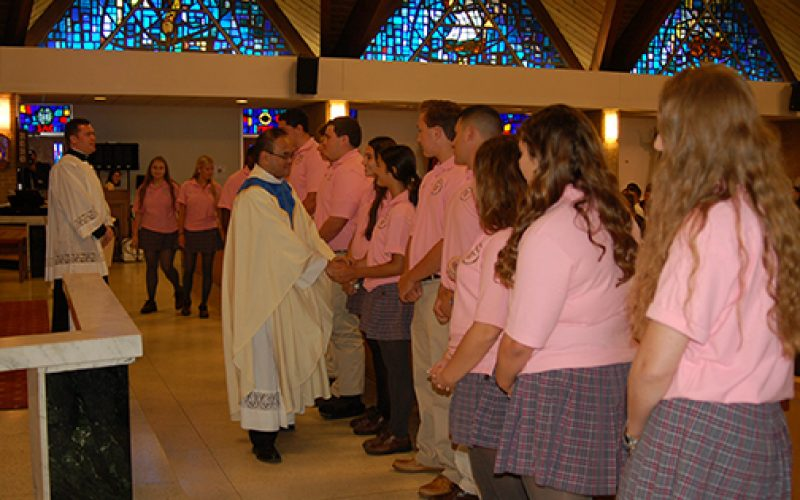 Bishop installs priest as school president/principal