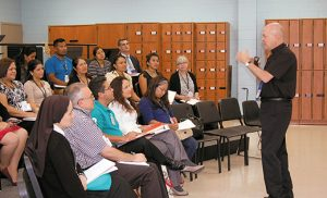 "Father Alejandro Lopez-Cardinale, from Venezuela, leads a Spanish-language workshop, ""El Catequista: Testigo Vivo del Evangelio,"" during last Saturday's diocesan Catechetical Convocation at Paul VI High School, Haddon Township. Photo by James A. McBride"