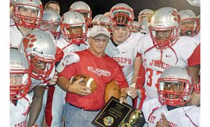 Saint Joseph High School football's head coach Paul Sacco further cemented his legacy in South Jersey sports last weekend, becoming the first coach in the area's history to reach 300 victories. On Friday, Sept. 9, the Wildcats defeated Mainland 50-7. Win number 1 came on Sept. 25, 1982, in his first game as Saint Joseph's head coach. At left, Sacco and his current squad celebrate the milestone. Photo by Paul Sacco, Sr.