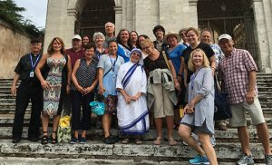 Msgr. Michael Mannion, far left, stands with Camden Diocesan pilgrims last weekend outside Rome's Saint Gregorio al Cielo Convent where the Missionaries of Charity reside and where Saint Teresa of Calcutta once lived. Msgr. Mannion, Director of Community Relations for the Diocese of Camden, led the trip to Rome for the saint's canonization and was among the priests who concelebrated the liturgy on Saint Peter's Square with Pope Francis.