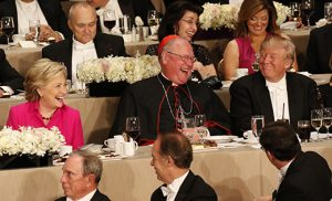 New York Cardinal Timothy M. Dolan shares a light moment with U.S. Democratic presidential nominee Hillary Clinton and Republican presidential nominee Donald Trump during the 71st annual Alfred E. Smith Memorial Foundation Dinner at the Waldorf Astoria hotel in New York City on Oct. 20. The charity gala, which honors the memory of the former New York Democratic governor who was the first Catholic nominated by a major political party for the U.S. presidency, raises money to support not-for-profit organizations that serve children in need. CNS photo/Gregory A. Shemitz