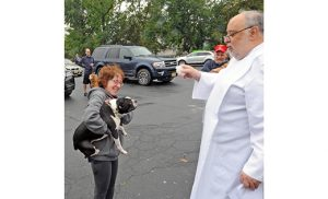 Father Peter M. Saporito, pastor, blesses Drake, above, and Nikko, below, at Saint Mary of Mount Carmel Parish, Hammonton, on Oct. 1. The blessing was held in observance of the Oct. 4 feast of Saint Francis of Assisi, patron of animals. Photos by Alan M. Dumoff, more photos ccdphotolibrary.smugmug.com