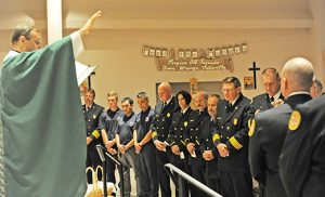 Father John J. Vignone, pastor, blesses firefighters and law enforcement officers at the end of the Blue Mass at Saint Katharine Drexel Church, Egg Harbor Township, on Oct. 1. Photo by Alan M. Dumoff, more photos ccdphotolibrary.smugmug.com