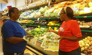 "Workshop attendees compare unit prices and retail prices at Incollingo's Market in Penns Grove. The ""Cooking Matters at the Store"" Program, funded in part through a Catholic Charities grant, educates individuals on how to get the most nutrition and how to stretch their food dollars."