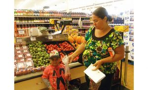 A workshop participant and her son participate in the $10 meal challenge at Incollingo's Market in Penns Grove.