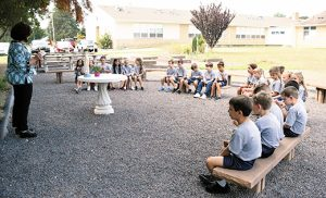 Second grade students pray the rosary in the outdoor classroom at Saint Mary School, Vineland.