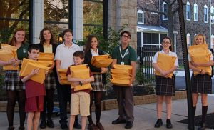 With their arms full of letters to be mailed to legislators are, in front, brothers Paul and Patrick McInerney from Christ the King School, Haddonfield, and in back Erin Wilson and Sarah Robbins of Camden Catholic High School, Cherry Hill; Josh Kolasa of Resurrection, Cherry Hill; Alessandra Kinney Farraro and Chris Stefanacci of Camden Catholic; and Grace Pierlott and Alexandra Senior of Resurrection. Photo by James A. McBride