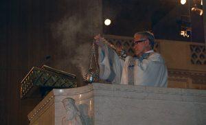 Deacon Thomas Fargnoli censes the Good News before reading the Gospel. Photos by James A. McBride