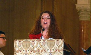 Cantor Abigail Walsh leads the congregation during the pilgrimage liturgy.