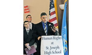 Students from several local schools converged at Saint Joseph High School, Hammonton, on Oct. 21 for United Nations Day 2016. Students developed pledges of action on the issues of self image, air quality, and domestic abuse. The conference topic was universal happiness. Above, Saint Joseph student Jack Peacock at the podium, addressing Demetrios Argyriades, special envoy of the United Nations, who addressed the students via satellite. Photo by Alan M. Dumoff
