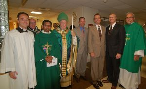 Bishop Dennis Sullivan celebrated the annual White Mass for healthcare workers Oct. 23 in the chapel of Our Lady of Lourdes Medical Center, Camden. During the Mass, the bishop and Gerald V. Burke, M.D., president of the South Jersey Medical Association, presented the Saint Luke Award to two physicians, Reginald Blaber, M.D. and James P. Dwyer, D.O., for promoting Catholic principles and values in healthcare in South Jersey. Pictured from left are Father John Rossi, master of ceremonies; Father Joseph Monahan, director of pastoral care at Our Lady of Lourdes; Father Jerold Cruz, chaplain at Cooper Health System; Bishop Sullivan; Dr. Dwyer; Dr. Burke; Dr. Blaber; and Deacon Gerard Jablonowski, executive director of VITALity Catholic Healthcare Services. The annual White Mass is sponsored by VITALity and the South Jersey Catholic Medical Association. Photo by James A. McBride