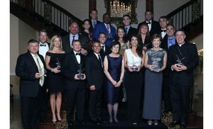 Paul VI High School, Haddon Township, celebrated its 50th Anniversary and Hall of Fame Induction with the Blue and White Gala on Oct. 15, at Lucien's Manor in Berlin. At the gala, eight individuals, one family and one athletic team were honored for their outstanding contributions to both Paul VI and the larger community. On the far right is Bishop James F. Checchio of Metuchen, Class of 1984, who was honored for Lifetime Service to the Catholic Church.