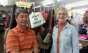 Store manager Dennis Chang stands with Cathy Rainey, president of the Saint Simon Conference of the Society of Saint Vincent de Paul, in the Saint Vincent de Paul Thrift Store in Berlin.