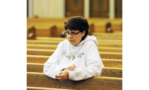 Prayers for the country A woman prays at Vineland's Sacred Heart Church on Election Day. The Vineland Catholic Collaborative (Christ the Good Shepherd, Divine Mercy and Saint Padre Pio) held a day of prayer with the rosary, adoration, benediction and other devotions. Photo by Alan M. Dumoff