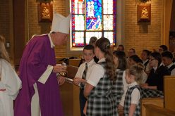 Bishop Checchio walks familiar hallways