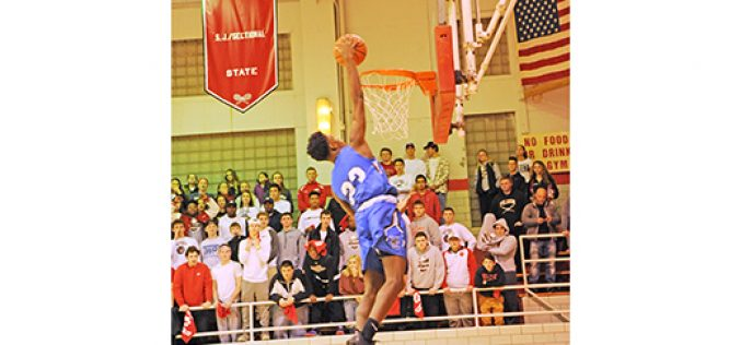 High school boys' basketball action
