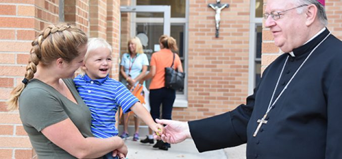Bishop Sullivan encourages students during school visits